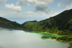 Amazing landscape view crater volcano lake in Sao Miguel island of Azores in Portugal in turquoise color water Royalty Free Stock Photography