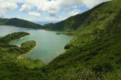 Amazing landscape view crater volcano lake in Sao Miguel island of Azores in Portugal in turquoise color water Royalty Free Stock Photos