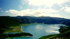 Amazing landscape view of Sao Miguel island coast in Azores Port. Ugal from top tourist viewpoint in cloudy sky and beautiful soft light shining on the atlantic stock footage