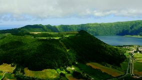 Amazing landscape view of Sao Miguel island coast in Azores Port. Ugal from top tourist viewpoint in cloudy sky and beautiful soft light shining on the atlantic stock video