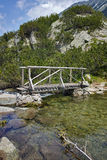 Amazing Landscape of Wooden bridge over River near Vihren hut, Pirin Mountain Royalty Free Stock Images