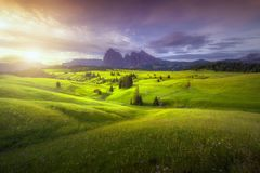 Amazing landscapes view of green hills with summer blue sky on sunrise from Seiser Alm Dolomites, Italy. Amazing landscapes view of green hills with summer blue royalty free stock photography