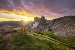 Amazing landscapes view of green mountain with gold sky on sunrise morning from Dolomites, Italy. Amazing landscapes view of green mountain with gold sky on royalty free stock photography