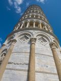 Amazing Leaning Tower of Pisa against blue sky royalty free stock images
