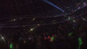 Amazing light effects at arena with thousands of people enjoying music show. Stock footage stock footage