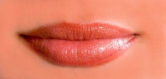 Amazing lips. Amazing red lips with texture, clean skin Royalty Free Stock Photo