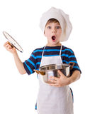 Amazing little chef opens the pot. Isolated on white Royalty Free Stock Photos