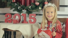 Amazing little girl with blue eyes and long white stock footage