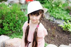 Amazing little girl in pink dress and white hat Royalty Free Stock Photo