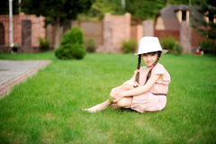 Amazing little girl in pink dress and white hat Stock Image
