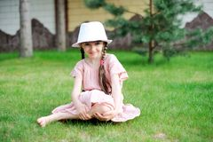 Amazing little girl in pink dress and white hat Royalty Free Stock Image