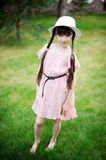 Amazing little girl in pink dress and white hat Royalty Free Stock Photos