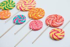 Amazing lollipops on sticks organised on white table. Sweet cara. Mel candy. Celebration concept Stock Image