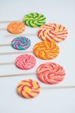 Amazing lollipops on sticks on white table. Sweet caramel candy. Celebration birthday concept Royalty Free Stock Photo