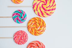 Amazing lollipops on sticks on white table. Sweet caramel candy. Amazing lollipops on sticks organised on white table. Sweet caramel candy. Celebration concept Stock Images