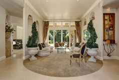 Amazing Luxury entrance Hallway interior with decorative trees in pots. Stock Photos