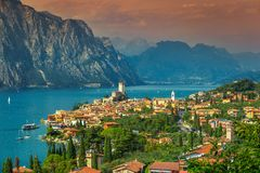Amazing Malcesine tourist resort and high mountains, Garda lake, Italy Royalty Free Stock Photo