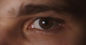 Amazing male green and grey coloured eye.  stock footage