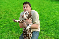 The amazing man with dog. Stock Images