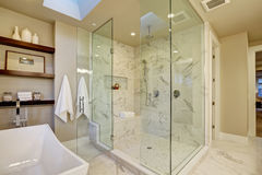 Amazing master bathroom with large glass walk-in shower Royalty Free Stock Photo