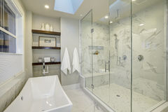 Amazing master bathroom with large glass walk-in shower Royalty Free Stock Images