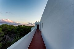 Amazing mediterranean sunset over white buildings of Cala d`Or, Mallorca stock photography
