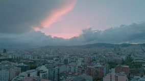 Pink inspiring dreamy sunset over urban city. Amazing mesmerizing and stunning sunset with pastel pink and blue colors over big urban city neighborhoods with stock footage