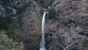 Amazing millomeris waterfalls in Cyprus mountains, aerial view in cliffs, top view. In summer day stock video footage