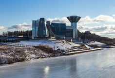 Amazing mirrored building on the banks of the frozen river on a Sunny day Royalty Free Stock Photo