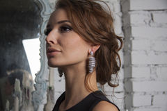 Amazing model with shiny jewelry and curly volume hair Royalty Free Stock Image