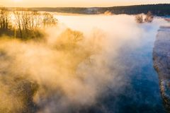 Amazing morning landscape. Countryside covered in fog aerial. River in morning. Beautiful landscape royalty free stock photography