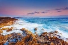 Seascape. Amazing morning sun over the sea. Volcanic island of Malta. Qawra, Europe. Beauty world. Retro toning effect Stock Photos