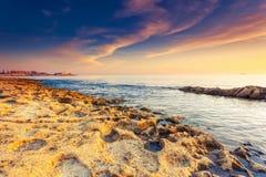Seascape. Amazing morning sun over the sea. Volcanic island of Malta. Sliema, Europe. Beauty world. Retro toning effect Stock Images