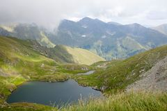 Amazing mountain lake in summer in Romania. Balea lake, the place of tourism Royalty Free Stock Images