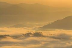 Amazing mountain landscape with dense fog. Royalty Free Stock Images