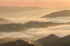 Amazing mountain landscape with dense fog. Royalty Free Stock Photos