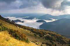 Amazing mountain landscape with low clouds in valley Royalty Free Stock Photos