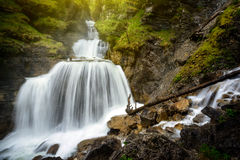 Amazing mountain waterfall near Farchant village at Garmisch Partenkirchen, Farchant, Bavaria, Germany. Royalty Free Stock Photography