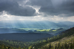 Amazing mountains landscape with dramatic clouds and sun rays Royalty Free Stock Image