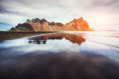 Amazing mountains reflected in the water at sunset. Stoksnes, Ic. Eland Royalty Free Stock Photography