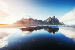 Amazing mountains reflected in the water at sunset. Stoksnes, Ic. Eland Royalty Free Stock Photos