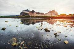 Amazing mountains reflected in the water at sunset. Stoksnes, Ic. Eland Royalty Free Stock Images
