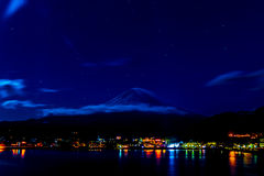 Amazing Mt. Fuji, Japan with the star on the sky at Lake Kawaguchi in the early morning before the sun coming up :HDR style.  royalty free stock photography