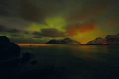 Amazing multicolored Aurora Borealis also know as Northern Lights in the night sky over Lofoten landscape, Norway, Scandinavia. stock image