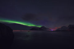 Amazing multicolored Aurora Borealis also know as Northern Lights in the night sky over Lofoten landscape, Norway, Scandinavia. stock photography