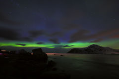 Amazing multicolored Aurora Borealis also know as Northern Lights in the night sky over Lofoten landscape, Norway, Scandinavia. royalty free stock photos