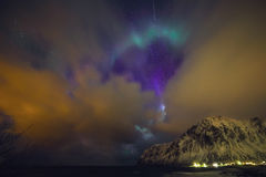 Amazing multicolored Aurora Borealis also know as Northern Lights in the night sky over Lofoten landscape, Norway, Scandinavia. Stock Images