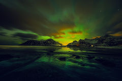 Amazing multicolored green Aurora Borealis also know as Northern Lights in the night sky over Lofoten landscape, Norway, Scandinav. Ia Stock Photography