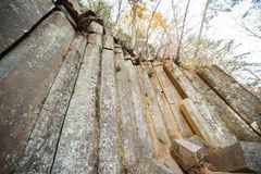 Amazing natural cliff of pentagonal boulders. royalty free stock photo