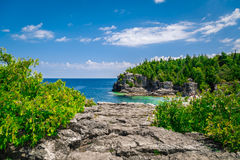 Amazing natural rocky beach landscape view and tranquil azure clear water at beautiful, inviting Bruce Peninsula, Ontario Royalty Free Stock Photo